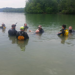 Instructor Jason Benjamin and Carl, the water rescue manikin, addressing students from Class 1702.