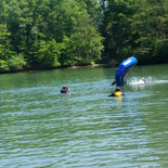 A Rescue Swimmer candidate from class 1702 learning to flip a raft over.