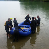 Instructor Jason Benjamin teaching students how to guide a raft.
