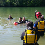 Instructor Benjamin demonstrating how to use a rescue can.