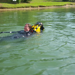 Rescue Swimmer candidate  Fenton-Peveto from class 1702 towing candidate Partridge.