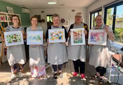 Students showcasing artwork 1