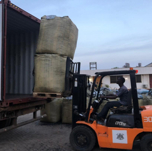 Loading Coconut Carbon into Containers - KDHI
