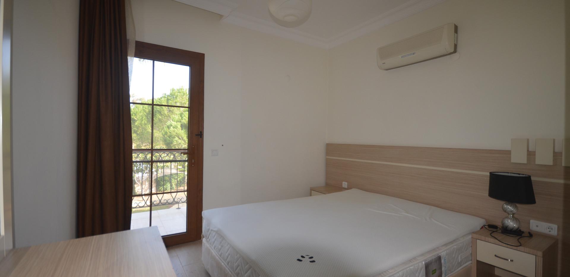 Bedroom has balcony off