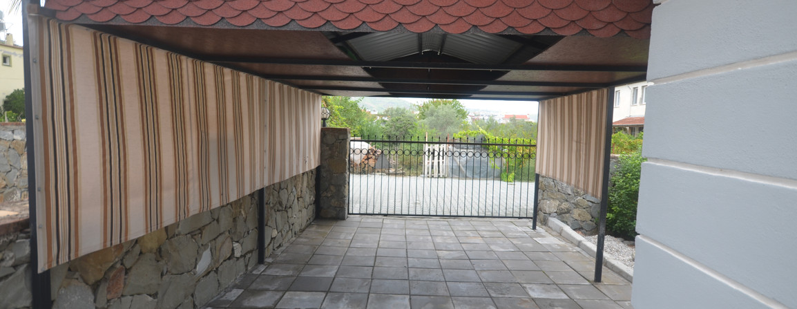 Gated Driveway with Car Port