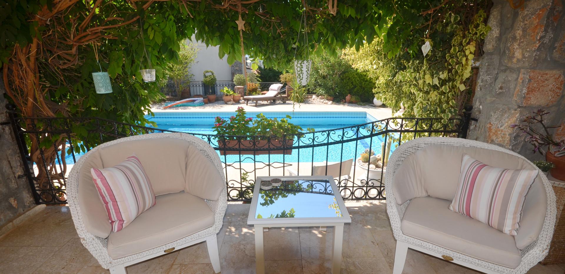 Shady Terrace Overlooks the Pool