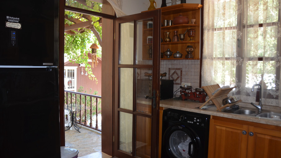 Kitchen has Balcony Off