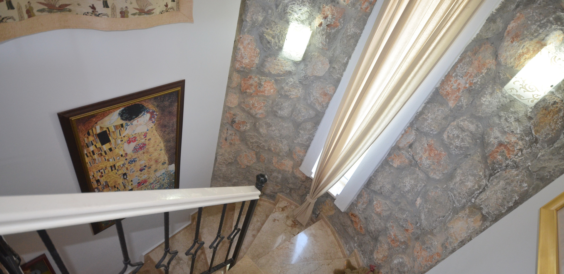 Exposed Stone Walls & Marble Stairs
