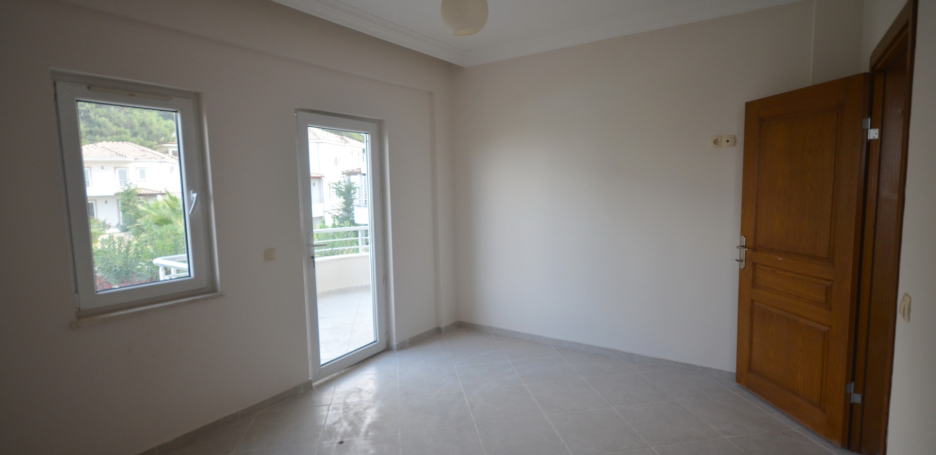 Bedroom One, with Balcony Off