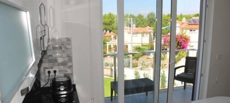 Kitchen has Rear Balcony O