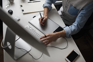 young-male-designer-using-graphics-table