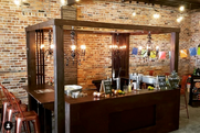 Three sided bar with chandeliers