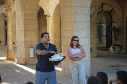 Two people evangelizing in the streets of Jerusalem.