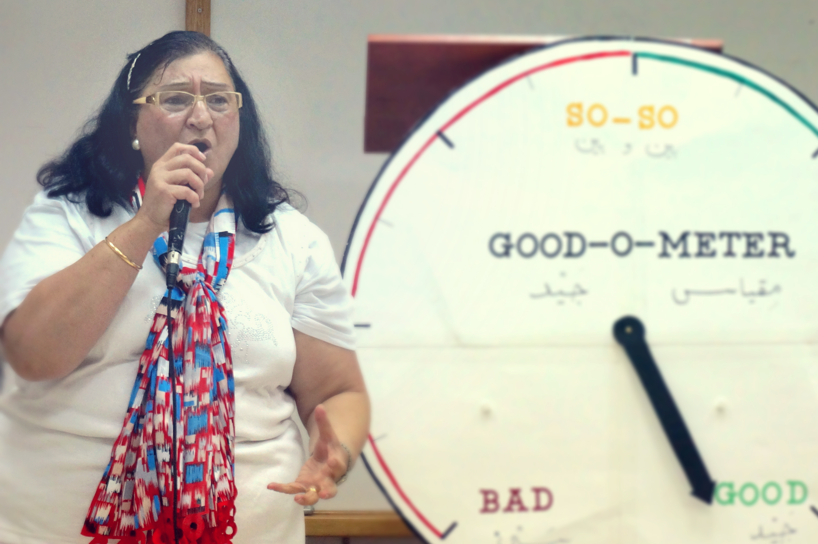 "A woman at FBC Bethlehem, speaking into a microphone while standing next to a large dial labeled ""Go"