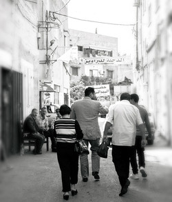 Pastor Steven Khoury walking down a street with a group of guys.