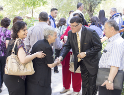 Dr. Naim Khoury greeting people as they walk into an FBC Bethlehem service.