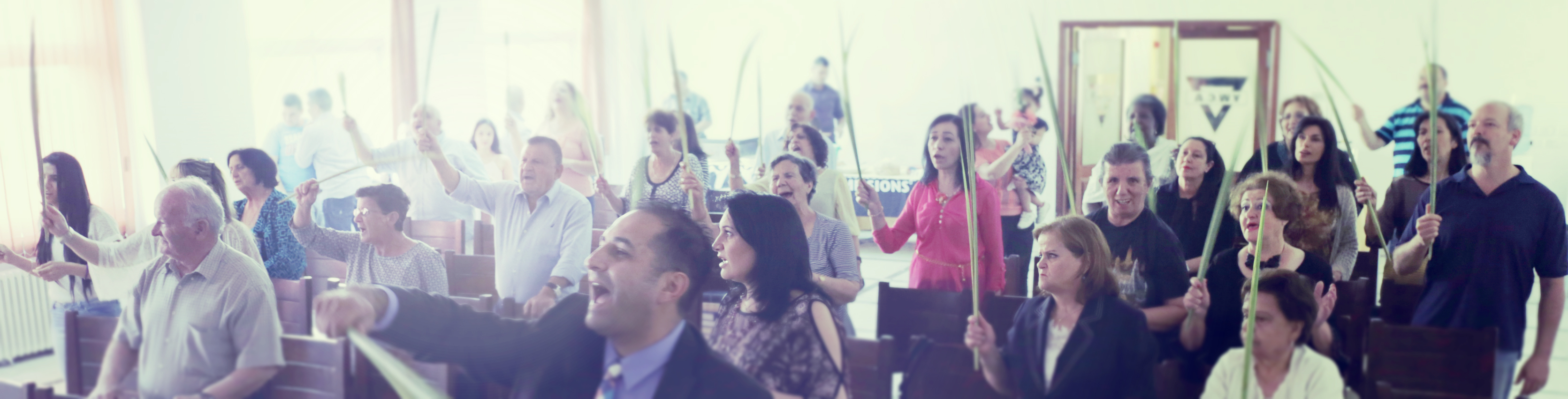 A group of Calvary Church members singing during a worship service.