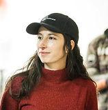 Marie B headshot with hat.jpg
