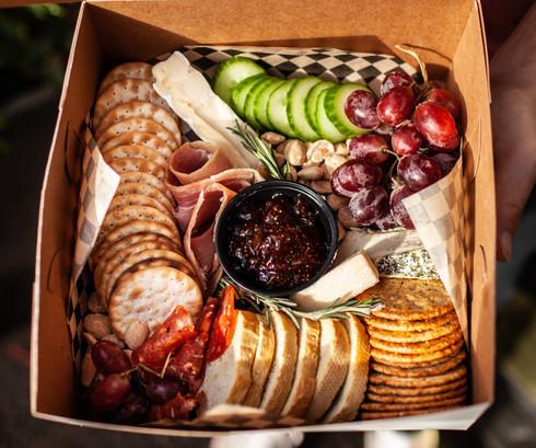 Crackers, fig spread, baguette, Marcona almonds