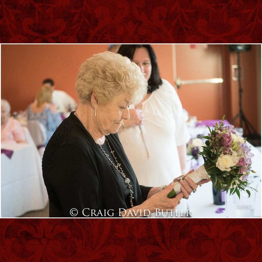 Aunt viewing photo of sister in the bridal bouquet. Michigan-Wedding-Photographer-Novi-CraigDavidButler
