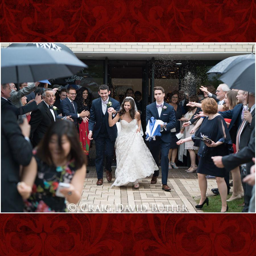 Wedding exit in the rain - Dearborn Inn Wedding Photo- Detroit Michigan Wedding Photographer - CDB Studios