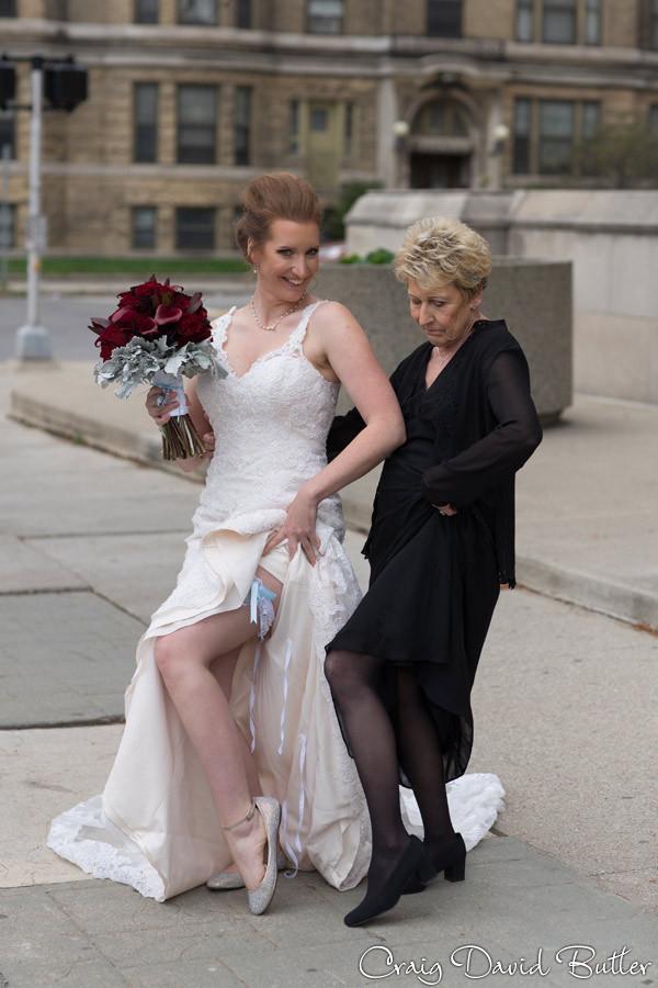 Bride & Mom cutting up Masonic Temple Detroit MI- Wedding Photographer Craig David Butler