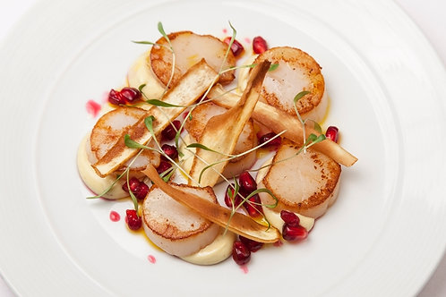 Scallops with curried parsnip purée, parsnip crisps & pomegranate