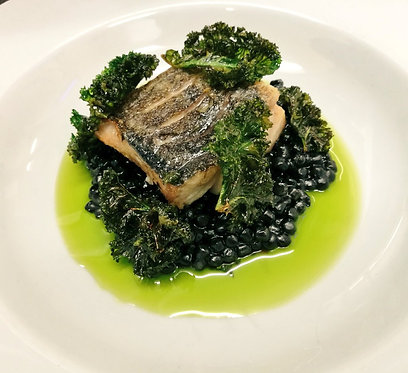 Hake fillet with squid ink fregola & kale crisps