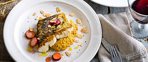 Squash, carrot and almond purée, roast hake and quick radish pickle