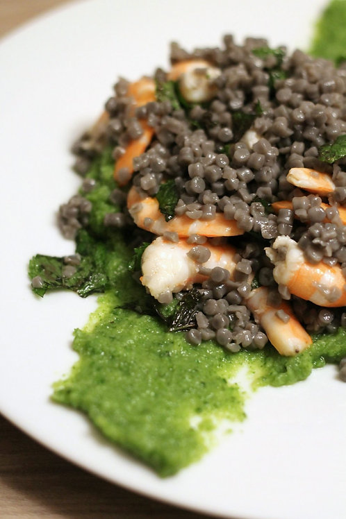 Fregola with squid ink with courgette cream & mint shrimp