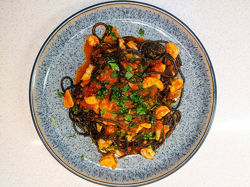 Squid ink spaghetti with prawns, 'nduja & tomato