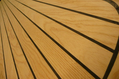 Enlglish Ash and sika flex striping finish on a diving board.