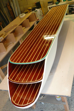 Carbon fibre diving board finished in white gloss, bubinga and holy veneers, with an aqua marine pin stripe.