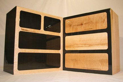 """Pair of """"opposites"""" chest of drawers in gloss carbon and birds eye maple."""