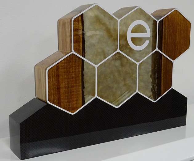 Carbon and wood epoxy display piece for entropy resisns.