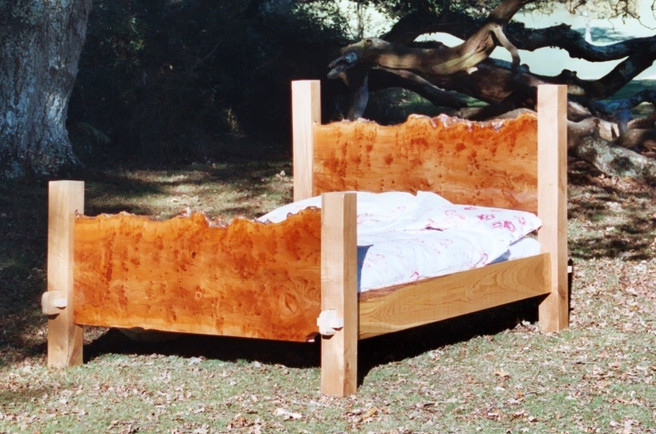 Burr London Plane double bed with english oak legs and sweet chestnut side boards.