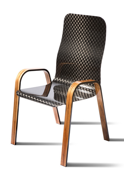 Chequerboard gloss carbon chair with zebrano wood legs.