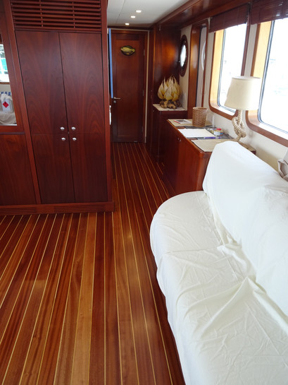 New floor made and installed on board a large motor yacht. Sepele with boxwood pin stripe