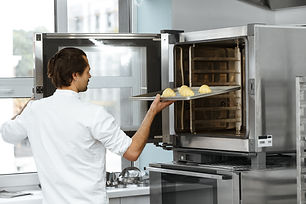 Man using an oven baker.jpeg
