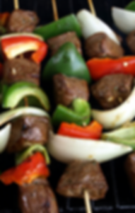 three steak and veggie kebabs