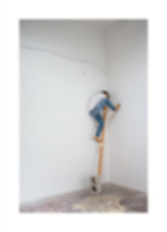 Artist Patricia Burns, Patricia D Burns, in her studio balancing on a pole in Chinatown, Los Angeles.