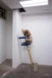 Patricia Burns photograph in her Chinatown Studio in Los Angeles, CA balancing on a 2 x 4