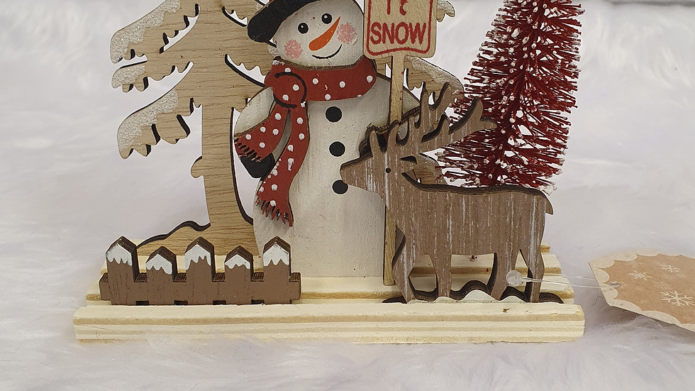Snowman woodland scene