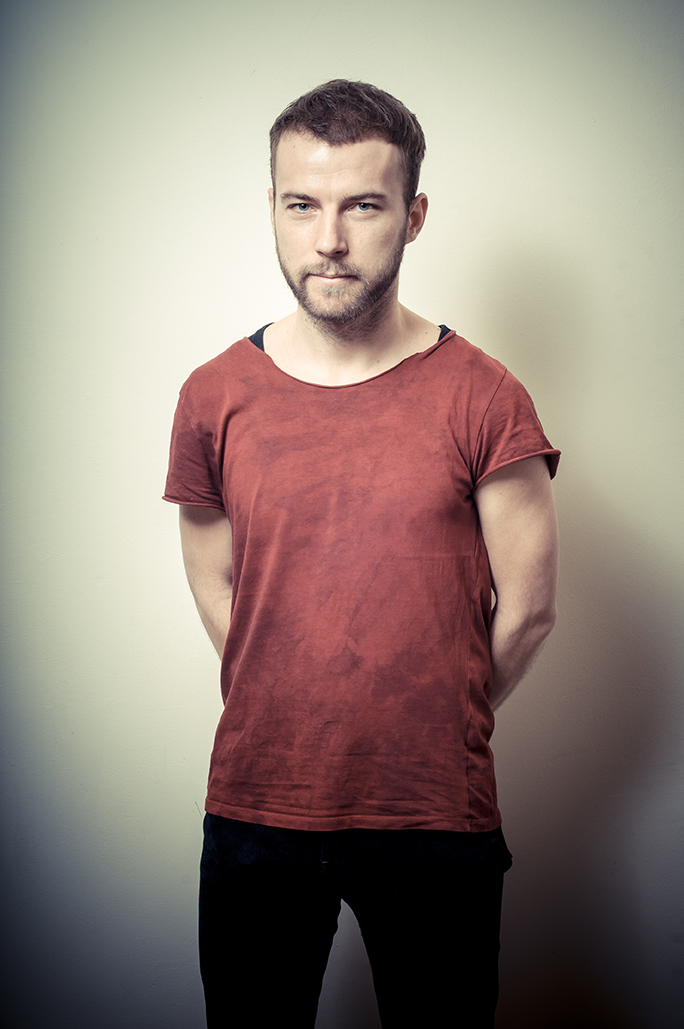Bearded hipster in red shirt