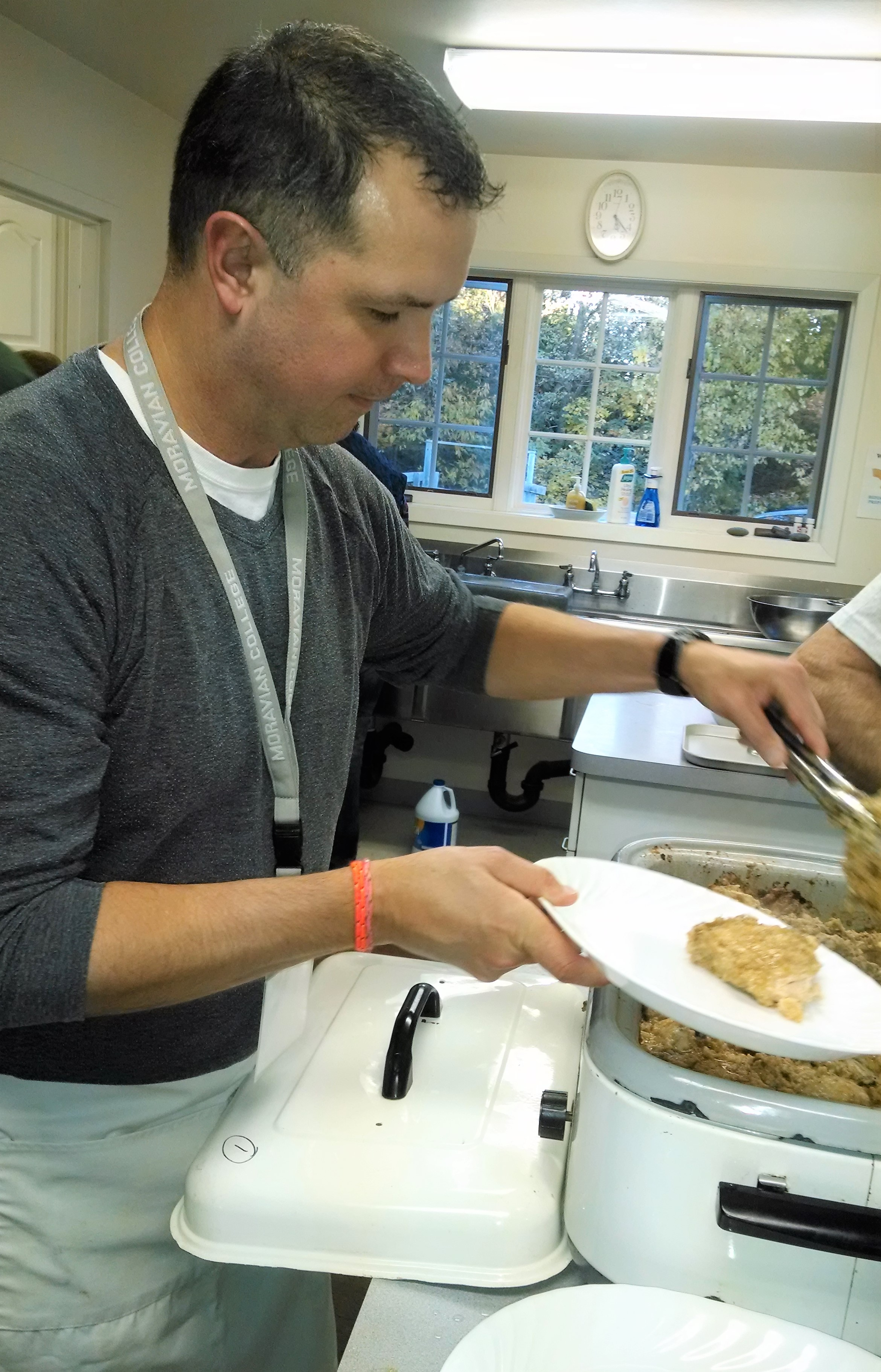 Pastor Kerry serving Famous Chicken Dinner