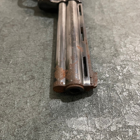 BEFORE: Rusted Colt Python