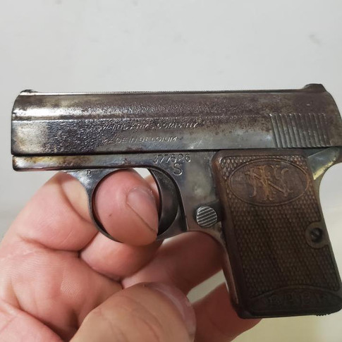 BEFORE: FN Baby Browning .25 ACP Pistol