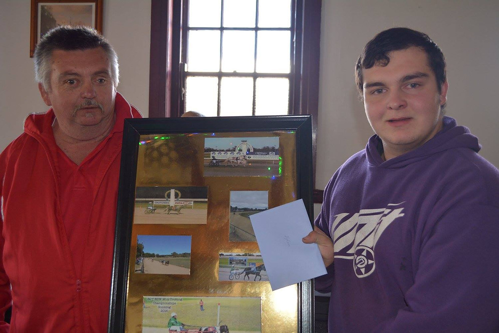 Leeton Mini Trots - Kenny Smith Prsesnts grandson Dylan with a collage of his Mini trotting driving career