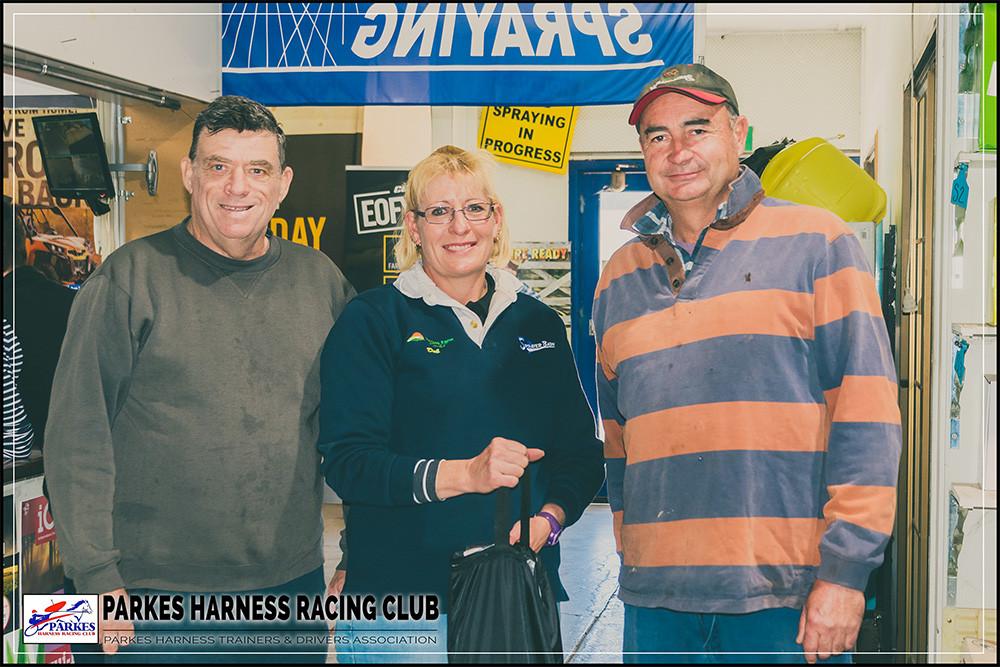 PARKES HARNESS Trainers and Drivers Association End Of Season Raffle Winner. Left: Bruce Dumesny (Parkes Harness Representative. Middle: Debbie Blaxland (Parkes Farm Centre Representative). Right: Darren Byrnes (Raffle Winner)