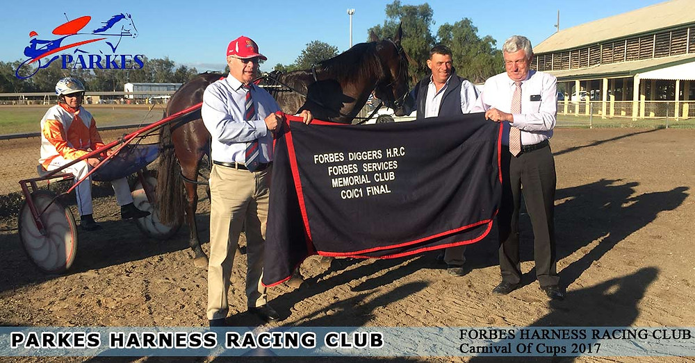Glenferrie Bazaar wins at Forbes Carnival Of Cups 2017.he is being taken care of Parkes local Bruce Dumesny.